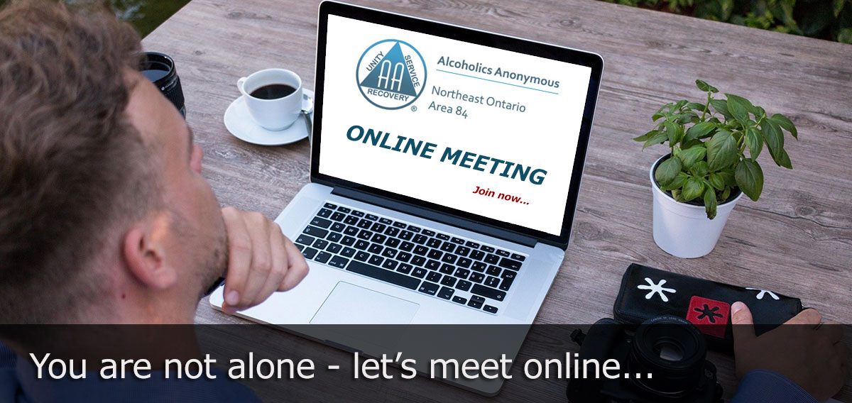 Image of man in front of computer: Invitation to online AA meeting